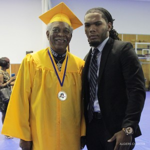 L.B. Landry class of 1956 graduate Winston Whitten stands with his grandson, Algiers Charter's O. Perry Walker class of 2011 graduate and current Landry-Walker English teacher, Byron Whitten, at Landry-Walker's May 2016 Commencement Exercise. (Photo by Nathaniel Colin, Jr., BAMM Communications)